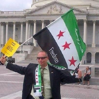Photo of Zionist Businessman Israeli Muti Khana holds FSA flag