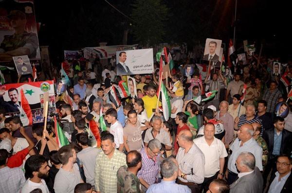 Photo of Photos- Syrians celebrate Dr. Bashar al-Assad's presidential victory