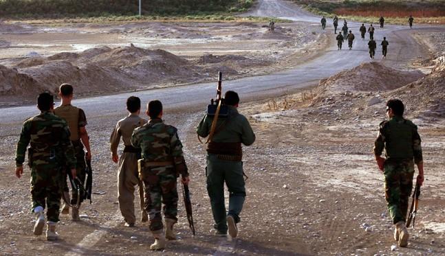 Photo of Kurdish Fighters Encounter ISIL Attacks against Kobani