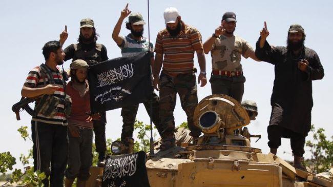 Photo of Insurgents, al-Qaeda fight in Syria's Idlib Province