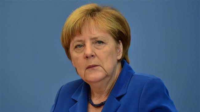 Photo of German chancellor defends 'open-door' refugee policy