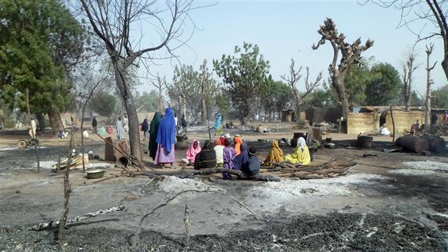Photo of 14 killed in suspected Boko Haram attacks in Nigeria
