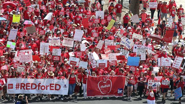 Photo of Mass teacher walkouts shut public schools in US West