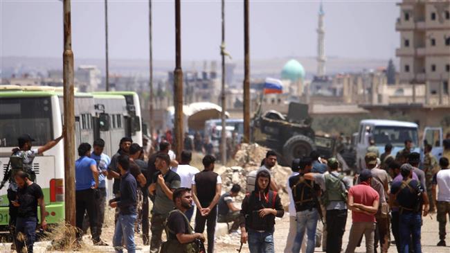 Photo of Syria militants begin leaving Dara'a under surrender deal